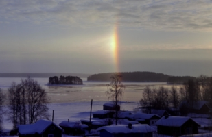 The winter rainbow over the lake