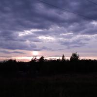 Закат за лесом...